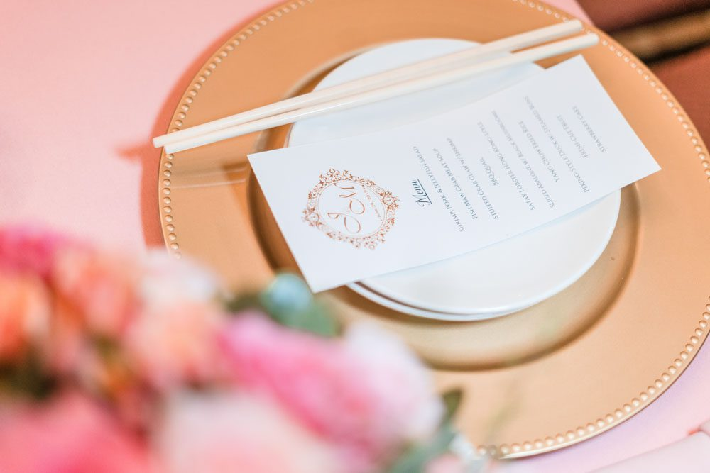 Close up of pink and gold table setting at the reception at Hy Palace in Oklahoma City