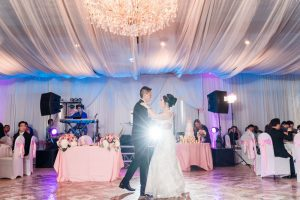 Bride and groom share their first dance at the Hy Palace in Oklahoma captured by traveling wedding photographers from Orlando