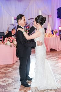 Top Orlando wedding photographers captures the bride dancing with her dad at Hy Palace in Oklahoma