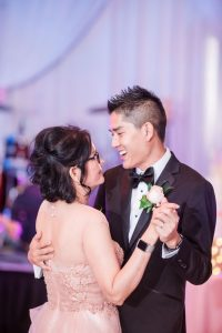 Top Orlando wedding photographers captures the groom dancing with his mom at Hy Palace in Oklahoma