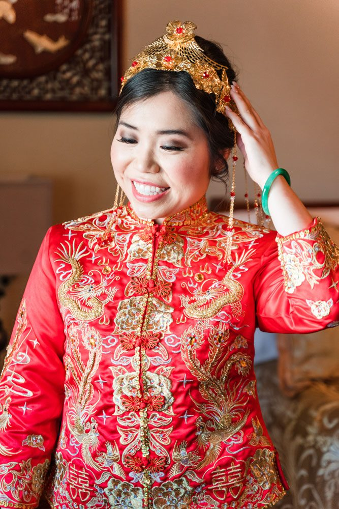 Chinese bride in her traditional Asian attire and headpiece as she prepares for her wedding day in Oklahoma City