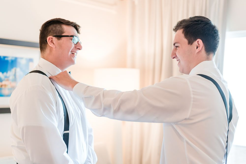 Groom getting ready with his groomsman captured by best Orlando wedding photography team