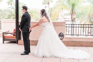 Funny First look between a bride and groom captured by top Orlando wedding photographer