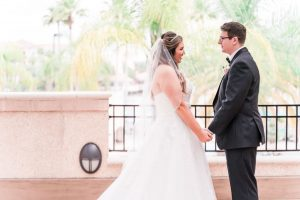 Romantic First look between a bride and groom captured by top Orlando wedding photographer and videographer
