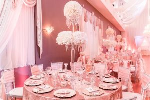 Blush pink, gold and white wedding reception decor at the Crystal Ballroom Veranda captured by top Orlando wedding photographer and videographer