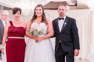 Bride makes her entrance into the wedding ceremony at the Crystal Ballroom in Orlando