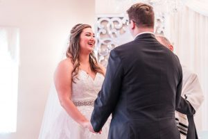 Bride and groom exchange vows during their Jewish wedding at the Crystal Ballroom captured by Orlando wedding photographer