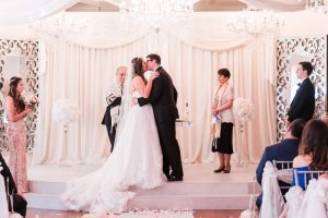Wedding ceremony at the Crystal Ballroom Veranda in Orlando captured by top wedding photographer and videographer