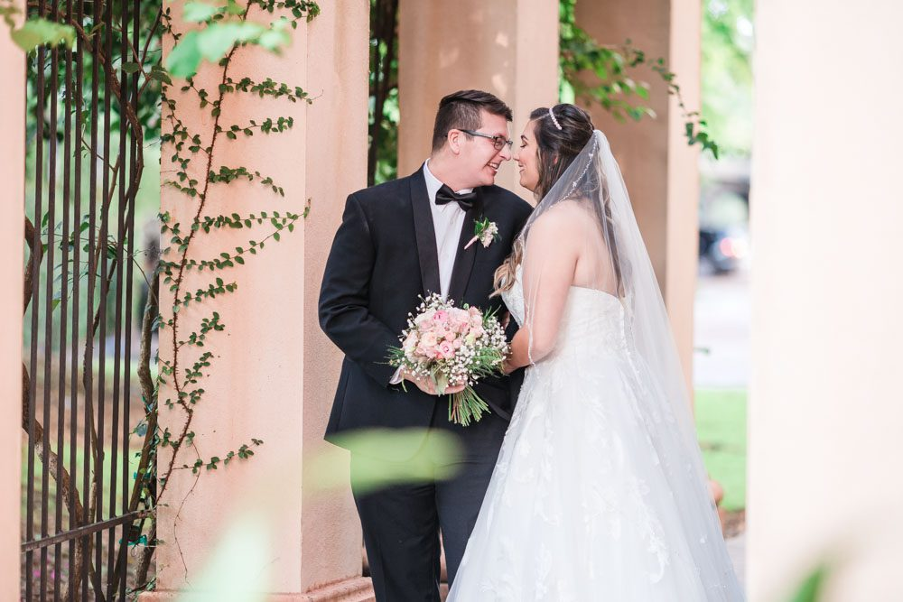 Romantic and candid bride and groom portraits at the Crystal Ballroom Veranda wedding venue captured by top Orlando wedding photographer