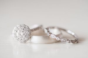 Close up photo of the wedding rings captured by top Orlando wedding photographer and videographer