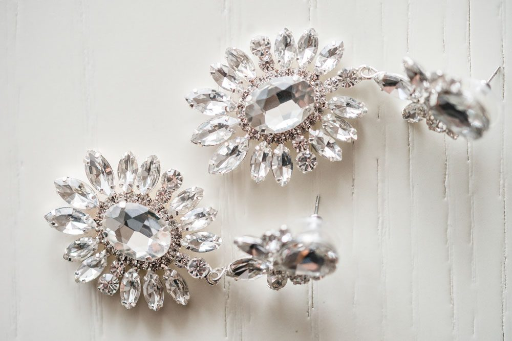 Close up photo of the bride's earrings captured by top Orlando wedding photographer and videographer