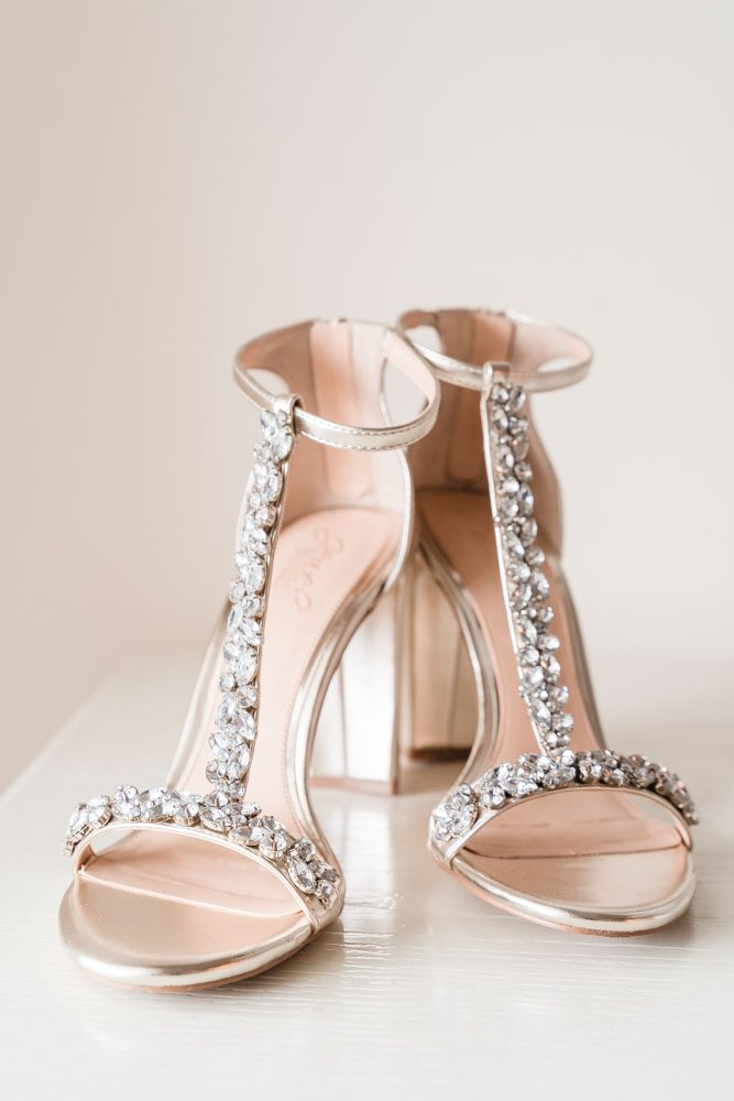 Close up of the brides gold bejeweled wedding heels for her Orlando wedding day at the Crystal Ballroom