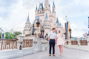 Engagement photo in front of Cinderella Castle in Magic Kingdom Disney World captured by top Orlando photographer