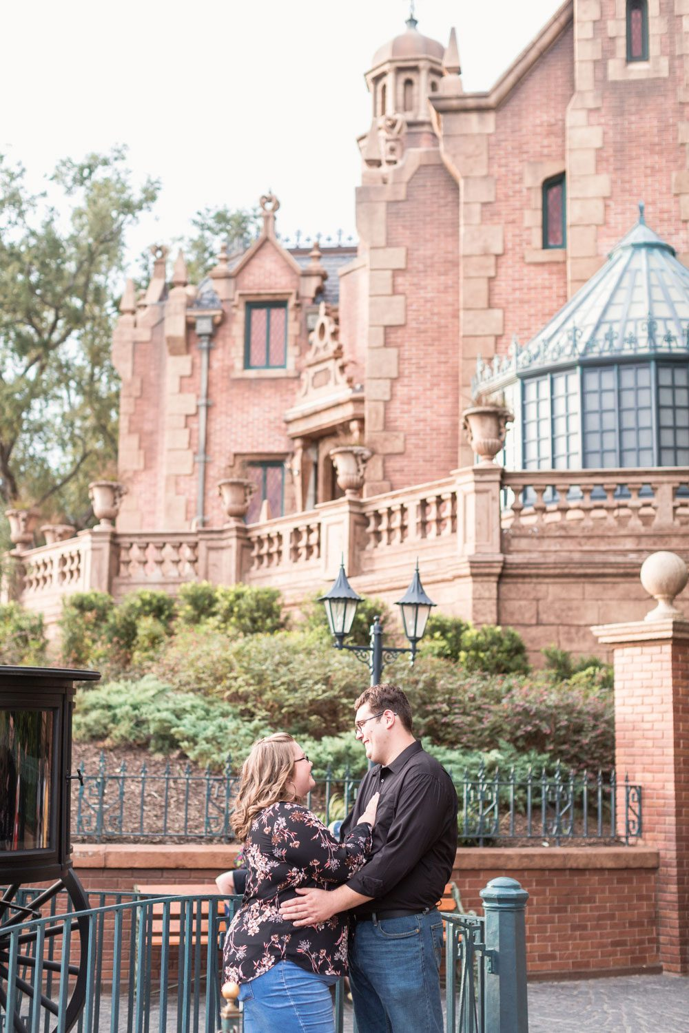 Disney engagement photo in front of the Haunted Mansion at Magic Kingdom in Orlando