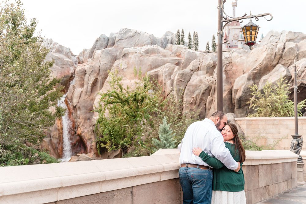 Disney engagement photo in front of the Beauty and the Beast castle in Magic Kingdom in Orlando