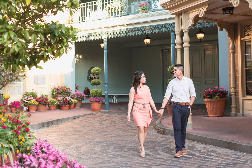 Couple walking in Magic Kingdom during their engagement session at Disney World in Orlando