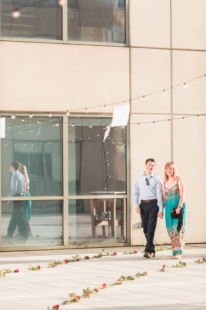 Romantic surprise proposal in Orlando at The Balcony captured by top engagement photographer