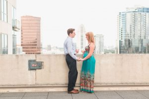 Orlando engagement photographer captures surprise proposal at The Balcony in downtown with skyline views at sunset