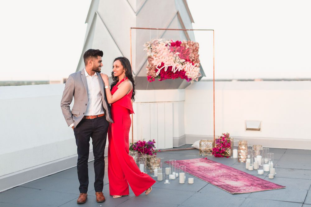 Orlando engagement photographer captures a surprise proposal at The Castle Hotel with sunset views of the ferris wheel