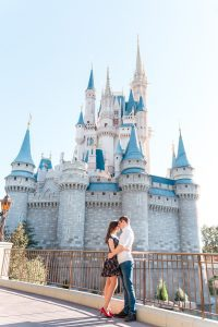 Engagement photo in front of the castle at Magic Kingdom in Orlando